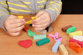 Child play with plasticine Royalty Free Stock Images