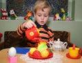 Child play tea Royalty Free Stock Image