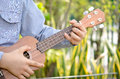 Child Play the ukulele Royalty Free Stock Photo