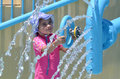 Child play with water fountain in water park Royalty Free Stock Photo