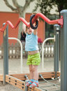Child at playground area in summer three year Stock Images