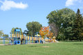 Child playground with blue sky and clouds Stock Image