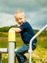 Child in playground kid in action boy play on leisure equipment Royalty Free Stock Photo