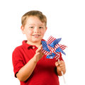 Child playing with American flag pinwheel Royalty Free Stock Photo