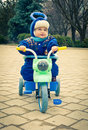Child playing on bicycle one year old outdoor Stock Photography