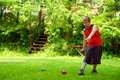 Child Playing Bocce Ball Royalty Free Stock Photo