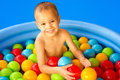 Child playing with colorful balls Royalty Free Stock Photo
