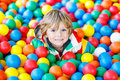 Child playing at colorful plastic balls playground Royalty Free Stock Photo