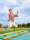 Child playing golf in park. Stock Photos