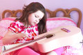 Child playing guitair Royalty Free Stock Image