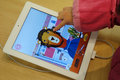Child playing ipad Royalty Free Stock Images