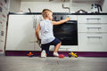 Child playing in the kitchen with a gas stove. Royalty Free Stock Photo