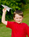 Child playing with paper airplane Stock Photography