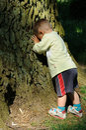 Child playing peek-a-boo Royalty Free Stock Photo