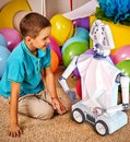 Child playing robot toy. Kid play in primary school. Royalty Free Stock Photo