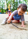 Child playing in sand Royalty Free Stock Images