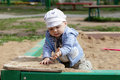 Child playing in sandbox Royalty Free Stock Photo