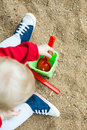 Child playing in the sandbox shovel baby sitting a Royalty Free Stock Photos