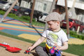 Child playing in sandbox with a toy car Royalty Free Stock Photography