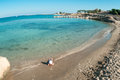 Child playing on sandy beach of mediterranean sea wide angle view small caucasian cyprus Stock Photography