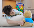 Child playing with teddy bear Royalty Free Stock Photos