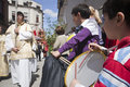 Child playing the toy drum linares jaen spain april during a procession of holy week popular tradition which remains for years Royalty Free Stock Photo