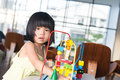 Child playing toy little asian girl with portrait Royalty Free Stock Photos
