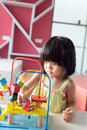 Child playing toy little asian girl with portrait Stock Photography