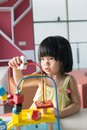 Child playing toy little asian girl with portrait Royalty Free Stock Images