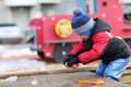 Child playing with toy in the sandbox at outdoor playground spring Stock Images