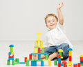 Child playing toys blocks over white happy background Royalty Free Stock Photo