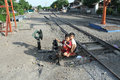 Child playing on train tracks at the station Sangkrah solo Central Java Indonesia. Royalty Free Stock Photo