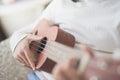 Child playing ukulele Royalty Free Stock Photo