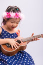 Child Playing Ukulele / Child Playing Ukulele Background Royalty Free Stock Photo