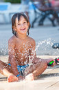 Child playing in water happy portrait sprinkler Stock Photos