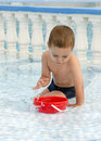 Child playing in water pool Royalty Free Stock Photo
