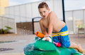 Child playing with water toy at kiddie pool during summer Royalty Free Stock Photo