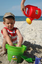 Child playint with toys on the beach Stock Images