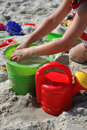 Child playint with toys on the beach Stock Photos