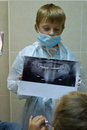 Child plays in a dentist choosing profession Royalty Free Stock Photo