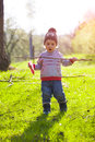 A child plays with a Frisbee outdoors. Royalty Free Stock Photo