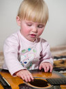 Child plays on guitar Stock Photography