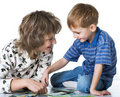 Child plays with mother Stock Photography