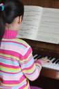 Child plays the piano Royalty Free Stock Photography