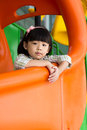 Child plays slide at playground Stock Images