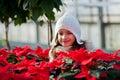 Child With Poinsettias