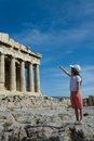Child points to  Ancient Parthenon Facade in Acrop Royalty Free Stock Photo