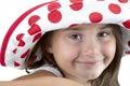 Child in polka dot hat