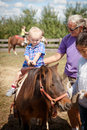 Child on Pony Ride Royalty Free Stock Photo