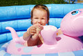 Child in pool sitting inflatable summer Royalty Free Stock Images